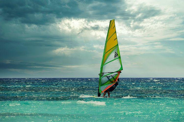 Umbrella on sea against sky