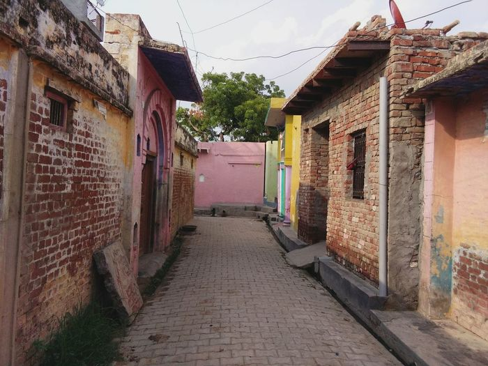 India UttarPradesh Bulandshehar Village Indianvillage Road Villagehomes Architecture House Built Structure Building Exterior Residential Structure The Way Forward Street Residential Building Narrow Window Long Day Walkway Sky Town Outdoors No People Footpath