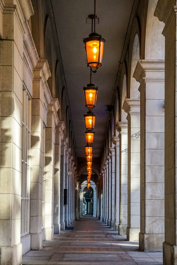 follow the light City Cityscape Lantern Illuminated Corridor Lighting Equipment In A Row Architecture Alley Colonnade vanishing point Passage Empty Road Pathway Column Diminishing Perspective Architectural Column Narrow Passageway