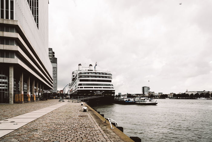Cruise ship moored in Rotterdam Port Architecture Architecture Building Building Exterior City City Cityscape Cloud - Sky Cruise Cruise Ship Day Dock Iconic Mode Of Transport Nature Nautical Vessel No People Outdoors Port Rotterdam Sky Transportation Travel Travel Destinations Water