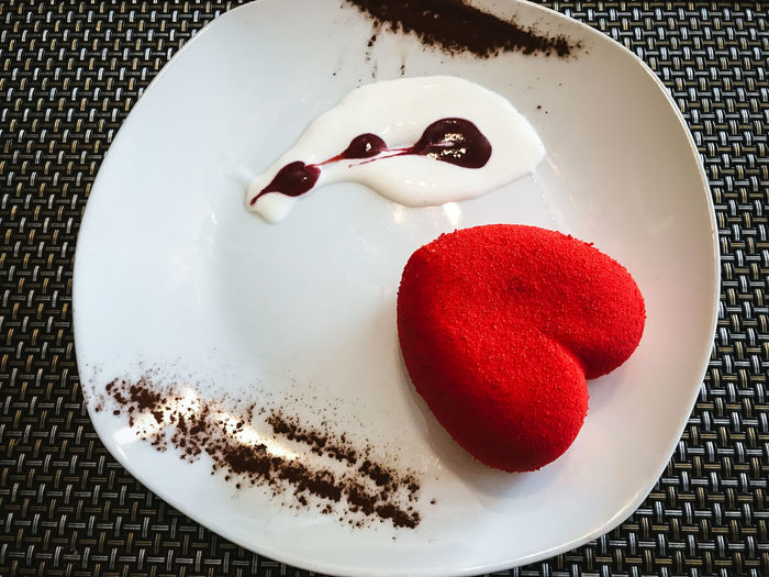 High angle view of heart shape in plate on table