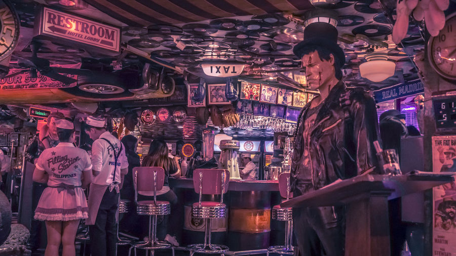 Filling station bar and restaurant Adult Choice For Sale Group Of People Illuminated Indoors  Large Group Of Objects Lighting Equipment Market Market Stall Men Night Nightlife People Real People Retail  Shopping Standing Store Variation Women