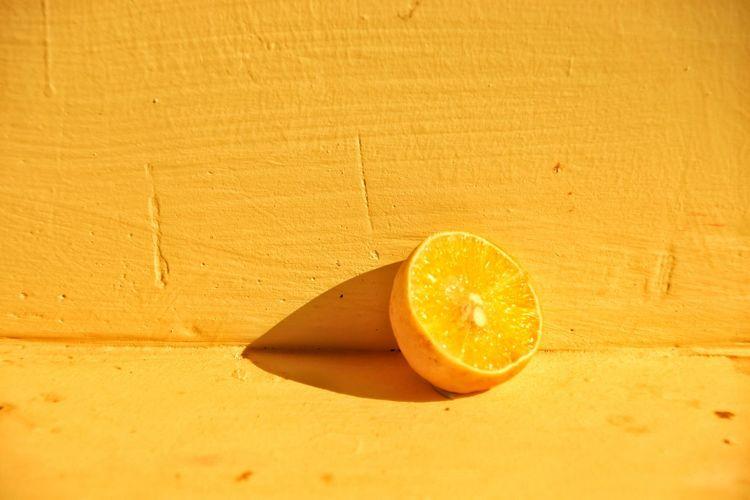 Close-up of orange slice on table