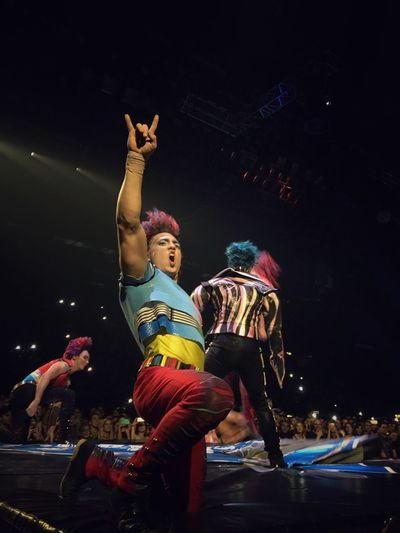 Cirque du Soleil Night Arms Raised Dancing Lifestyles Two People Fun Arts Culture And Entertainment Audience Crowd Nightlife Motion Illuminated Full Length Excitement Real People Performance Human Arm Men Music Festival Young Adult Popckorn