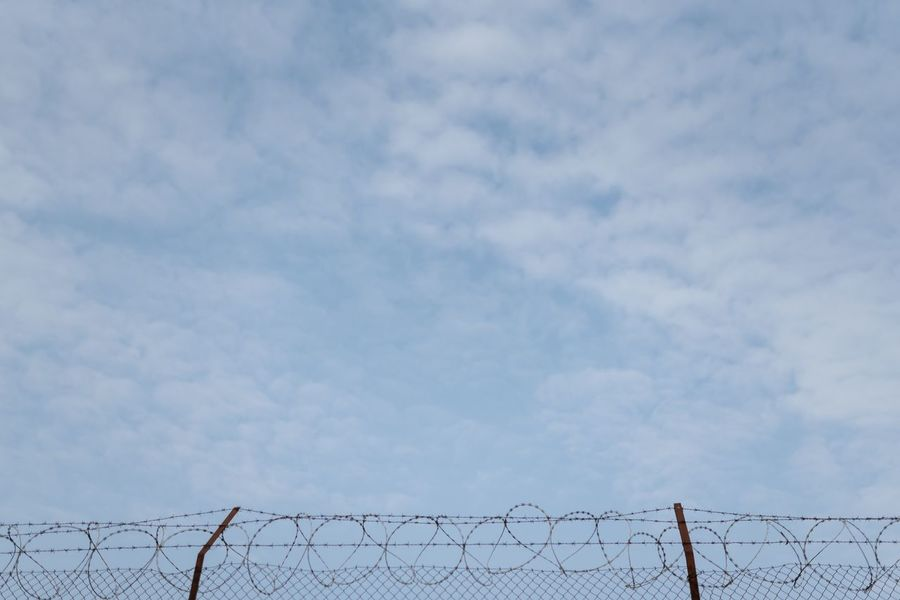 So many souls behind this fence. Sky Cloud - Sky Fence Boundary Low Angle View Barrier Barbed Wire Wire