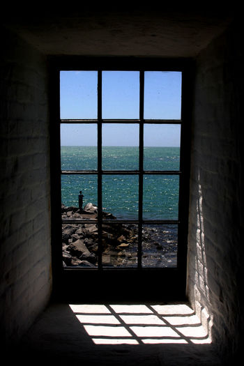 From inside the Key Biscayne Lighthouse in Miami, Florida Architecture Florida Key Biscayne Lighthouse Modern Sea Window Window View The City Light The City Light
