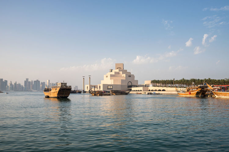 Doha, Qatar Water Waterfront Nautical Vessel Architecture Sky Transportation Nature No People Day Outdoors Doha Qatar Middle East Corniche Dhow Skyline Cityscape Building Museum Of Islamic Art Boat