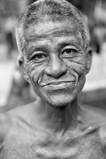 Close-up portrait of smiling senior man