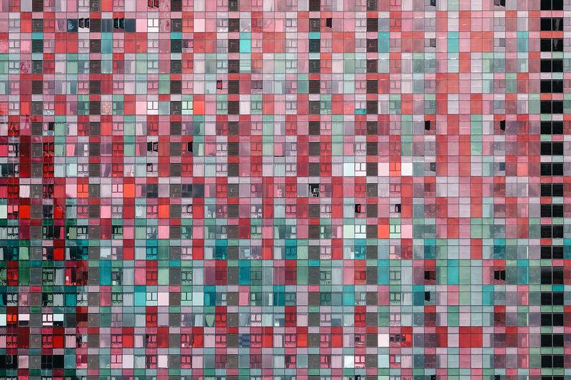 Full frame shot of multi colored residential building windows