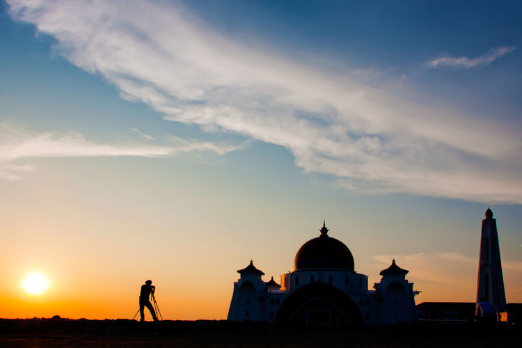 Silhouette strait of malacca mosque against sky during sunset