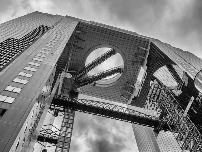 Umeda Sky Bldg. Japan Japan Photography OSAKA Osaka,Japan Architecture Bridge - Man Made Structure Building Exterior Built Structure City Connection Day Low Angle View Modern No People Outdoors Sky Skyscraper Street Streetphotography Travel Destinations Umeda Sky Building