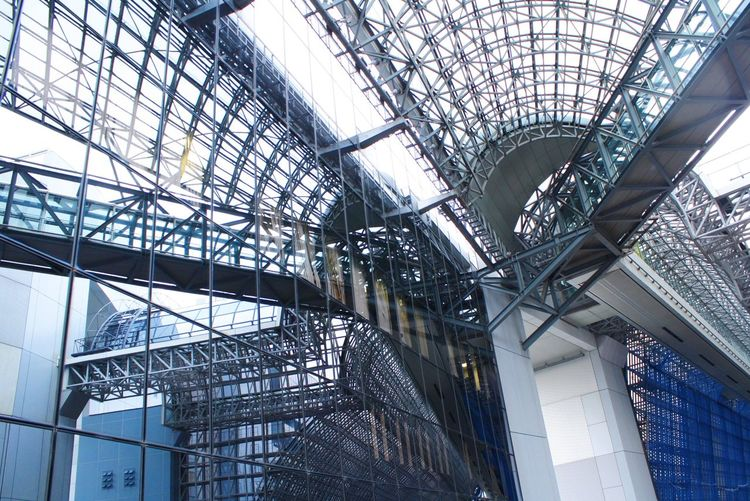 Low angle view of glass ceiling in building
