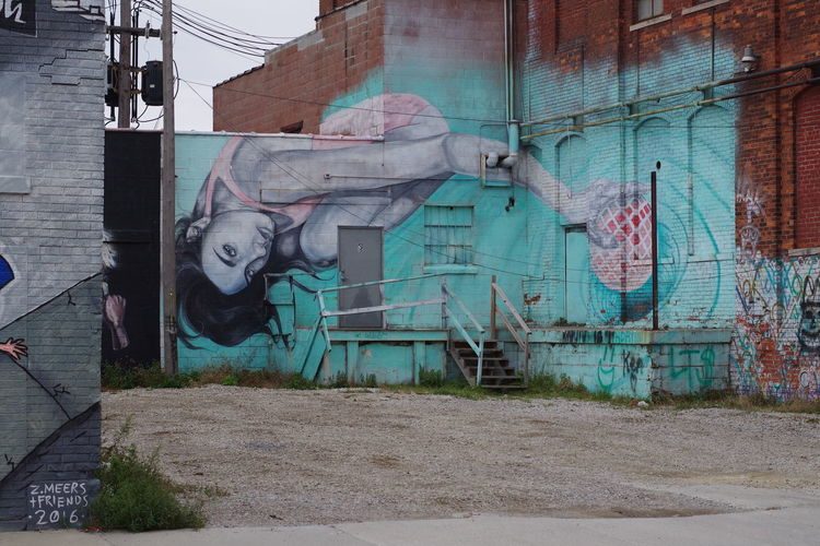 Graffiti on old building wall