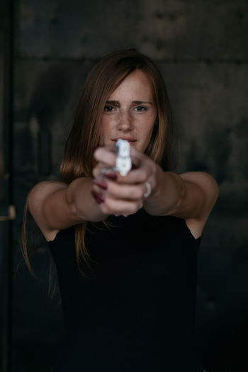 Portrait of a beautfiul ginger model with gun Alone Drama Gun Beautiful Woman Danger Dangerous Drink Drinking Freckles Front View Ginger Holding Kill Killer Lifestyles Looking At Camera Mistery One Person Portrait Real People Sexygirl Standing Women Young Adult Young Women