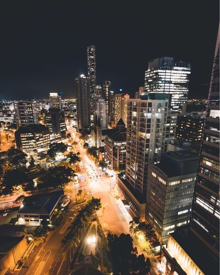 What Do I Say Night Skyscraper Illuminated City Cityscape Architecture Building Exterior City Life High Angle View Travel Destinations Modern Outdoors City Street Built Structure Urban Skyline No People Transportation Road Downtown District Growth