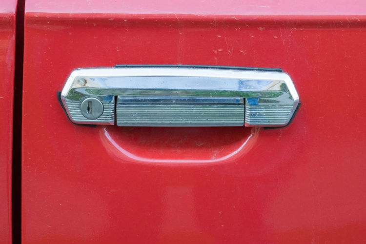 Lada car door handle. Brand of cars manufactured by Russian AvtoVAZ, Lada cars became popular in Eastern Europe during 1970s and 1980s, particularly in the former Eastern bloc LADA Transport Transportation Car Car Door Car Door Handle Car Doors Close-up Detail Door Door Handle Drive Handle Land Vehicle Metal Mode Of Transport Mode Of Transportation No People Nobody Red Vehicle Vintage Vintage Car Vintage Cars