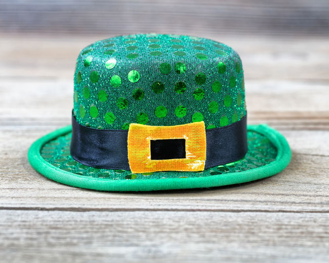 Lucky green hat for St Patrick in close up view Green Color Hat Holiday Luck St Patrick's Day Close-up Irish Springtime St Patrick Wood - Material