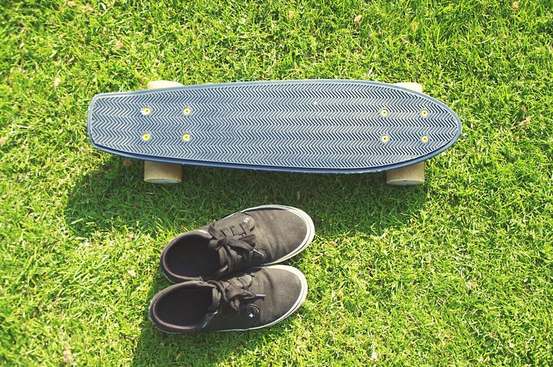 Skateboard and shoes Sneakers Skateboard Skating Grass High Angle View Green Color Shoe Plant No People Nature Sport Outdoors Sports Equipment Directly Above Day