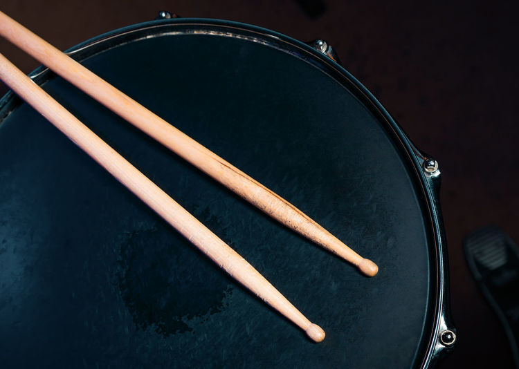 Drumsticks on a black snare background. Beautiful drumsticks. Music, concert concept. Drumstick Drum - Percussion Instrument Close-up Music Musical Equipment Musical Instrument Indoors  High Angle View No People Arts Culture And Entertainment Wood - Material Directly Above Still Life Black Color Chopsticks Two Objects Table Percussion Instrument Communication Single Object