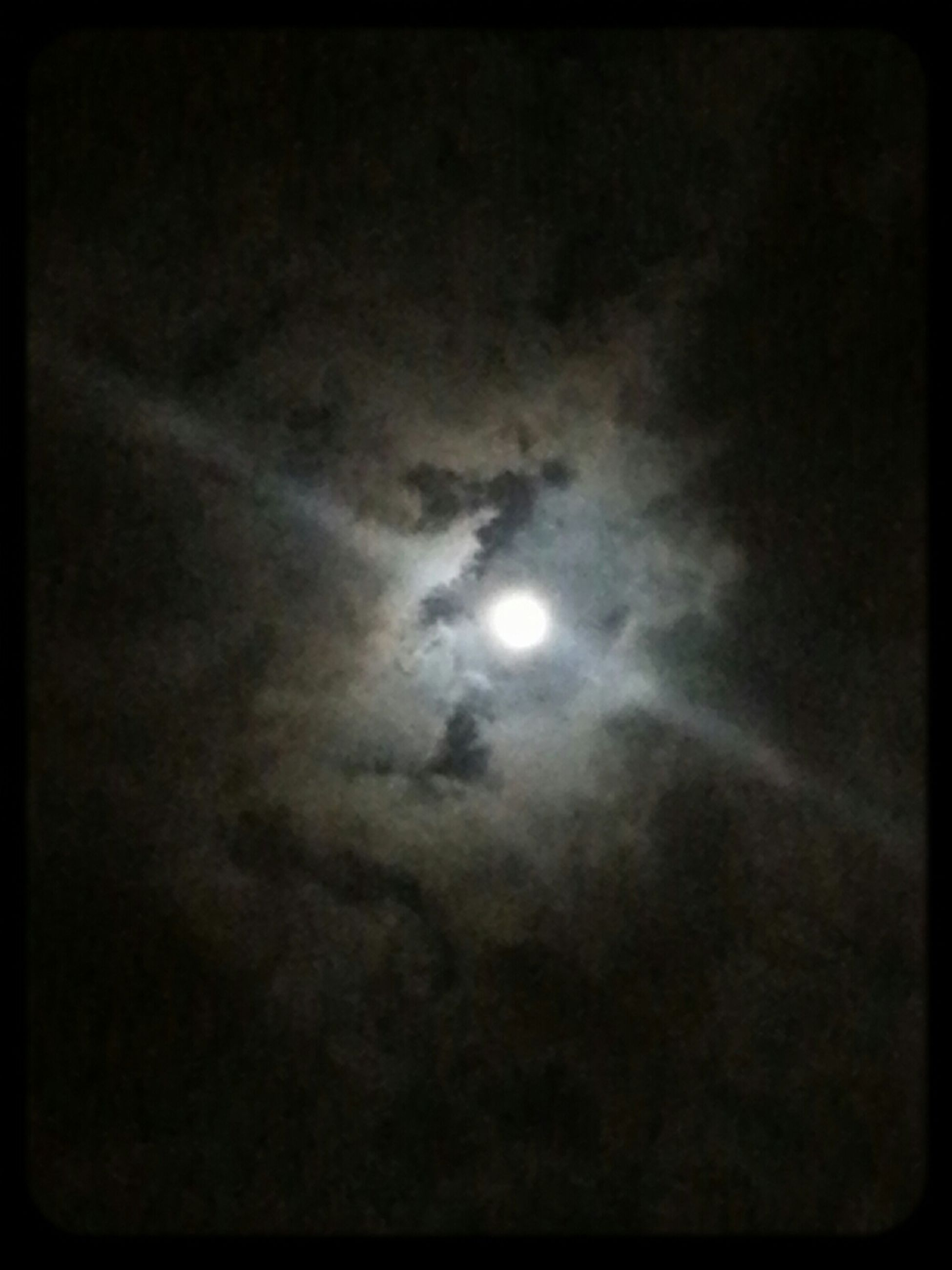 night, low angle view, sky, moon, transfer print, beauty in nature, auto post production filter, dark, scenics, nature, tranquility, weather, sky only, astronomy, tranquil scene, cloud - sky, illuminated, overcast, light - natural phenomenon, cloudy