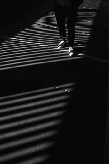 Storytelling EyeEm Best Shots Minimal Thoughts Blackandwhite Human Leg Shadow Real People Low Section One Person Body Part Human Body Part Pattern Lifestyles Walking Shoe High Angle View Standing My Best Photo