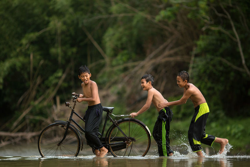 High angle view of men on bicycle against trees