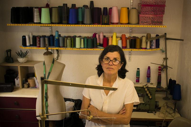 Portrait Of Fashion Designer Standing At Studio
