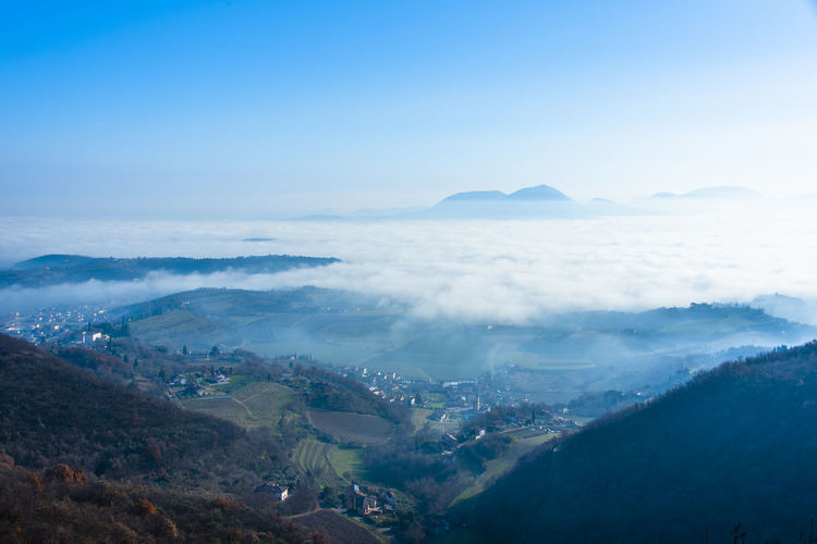 The fog rises from the plain between the berici hills in late autumn in villaga, vicenza italy