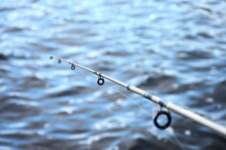Fishing pole Water No People Nature Day Focus On Foreground Drop Close-up Outdoors Selective Focus Fishing Rod High Angle View Lake Wet Summer Sports