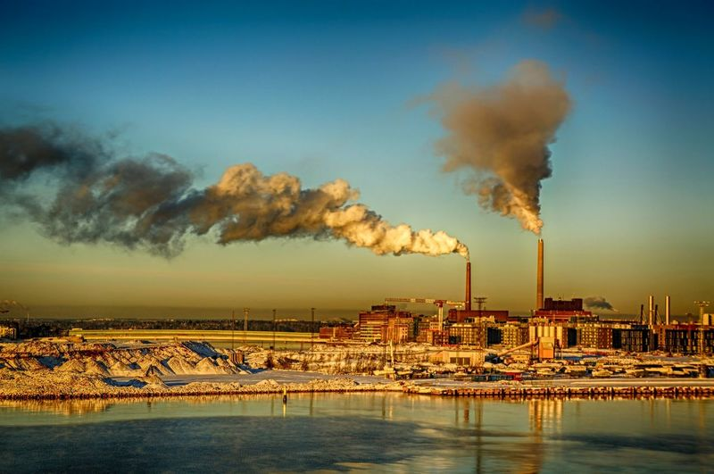 Finland Helsinki Scandinavia Winter Air Pollution Architecture Building Exterior Built Structure Capital Chimney Clear Sky Day Emitting Environment Europe Factory Fumes Global Warming Industry No People North Europe Outdoors Pollution Power Station River Sky Smoke - Physical Structure Smoke Stack Snow Tall Urban Water Waterfront