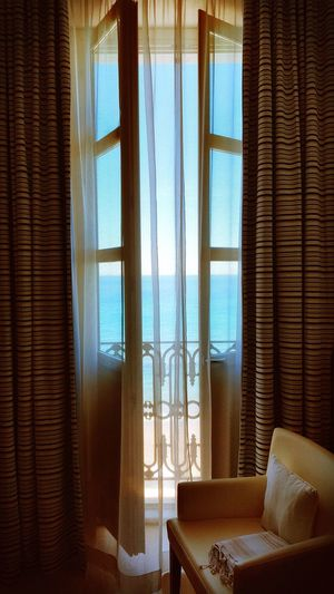 Schöne Grüße aus Italy Alassio Bay Ozean Blue Blue Sky Mare Window Sun Holiday Chair Through The Window Curtain Interior Interior Views Hotel Room EyeEm Gallery Relaxing Wunderful Day Beautiful Day Beautiful World From My Point Of View