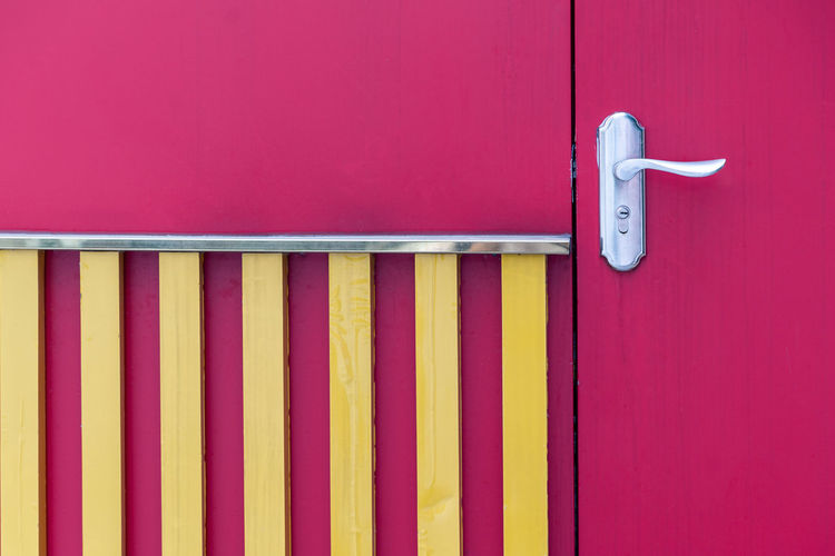 door Architecture Built Structure Close-up Closed Day Door Entrance Indoors  Latch Metal Multi Colored No People Pattern Pink Color Protection Purple Red Safety Security Vibrant Color Wall - Building Feature