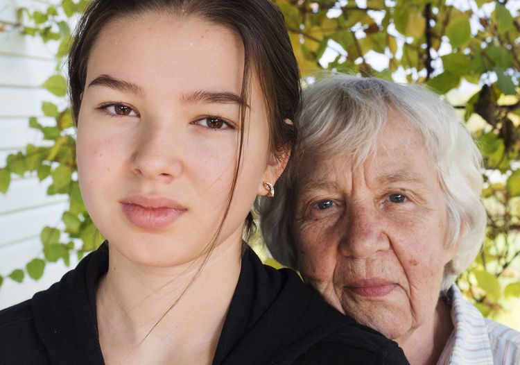 Close-up portrait of grandmother and granddaughter