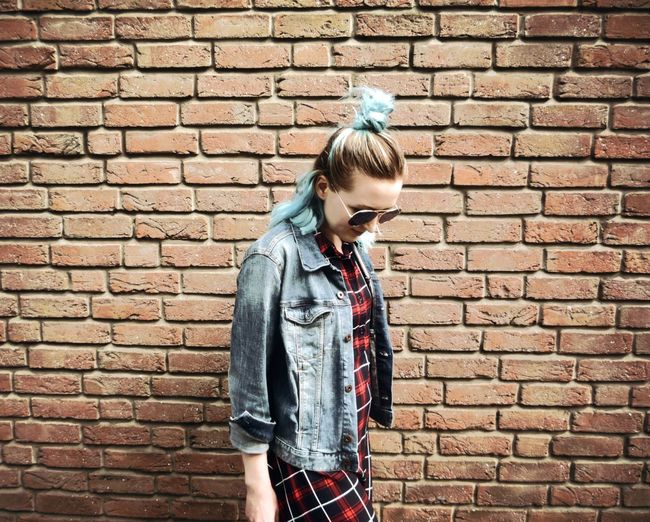 EyeEmNewHere Architecture_collection Streetphotography Streetlife GrungeStyle JustMe Alternative Architecture Blue Hair Brick Brick Wall Built Structure Casual Clothing Denim Denim Jacket Grunge Grungegirl Hairstyle Jacket Leisure Activity Lifestyles Real People Russian Girl Wall Wall - Building Feature Dyed Hair The Street Photographer - 2018 EyeEm Awards