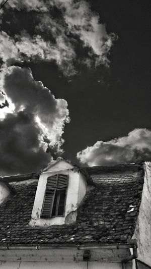 EyeEm Man Black And White Blackandwhite Photography Curtain Terasse Urban Window Wood Waithing Storm Cloud Sky Architecture Building Exterior Built Structure Cloud - Sky Residential Structure Human Settlement Exterior Rooftop Tiled Roof  House Residential Building