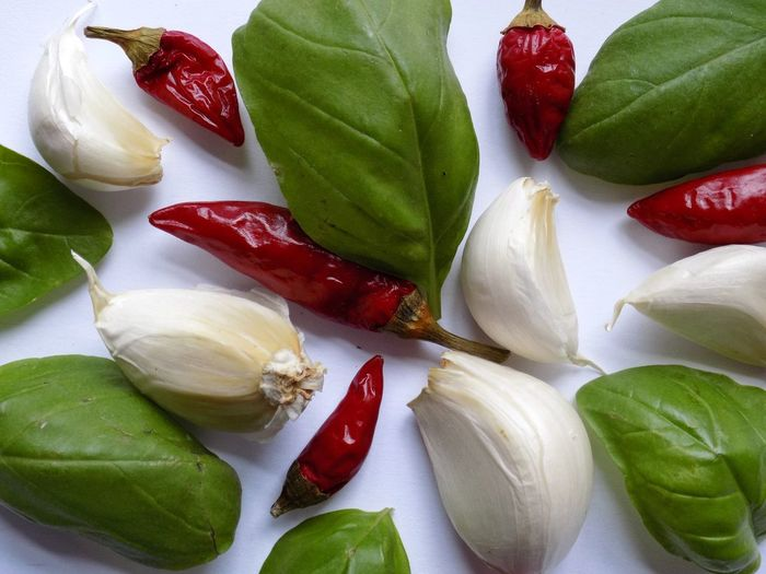 Seasoning EyeEm Best Shots Taking Photos Taking Pictures Seasoning Leaf Red Healthy Lifestyle Basil Beauty Vegetable Directly Above Raw Food Close-up Green Color Garlic Red Chili Pepper Cardamom Spice Garlic Clove Chili  Ingredient Garlic Bulb Clove Pepper - Vegetable