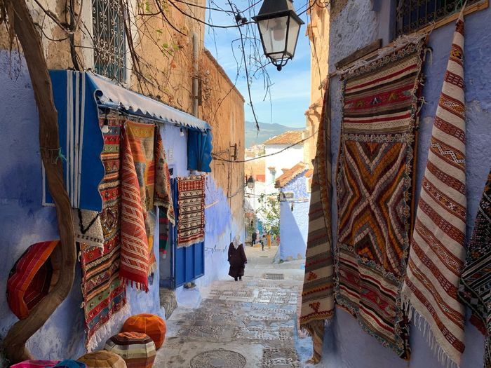 Tranquility Destination Morocco Carpet Blue Town Chefchaouen Blue Wall Blue Wall Chefchaouen Building Exterior Architecture Built Structure Day Building City Real People Retail  Decoration Street Outdoors Market