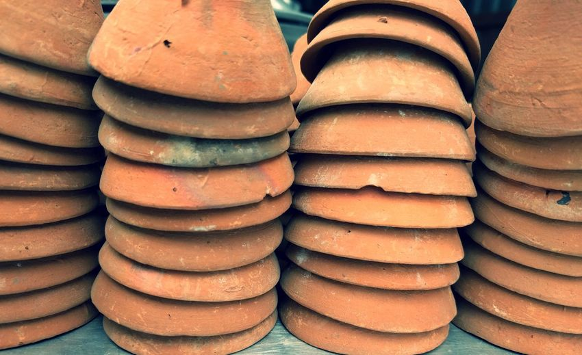 Close-Up Of Earthenware Stack On Table