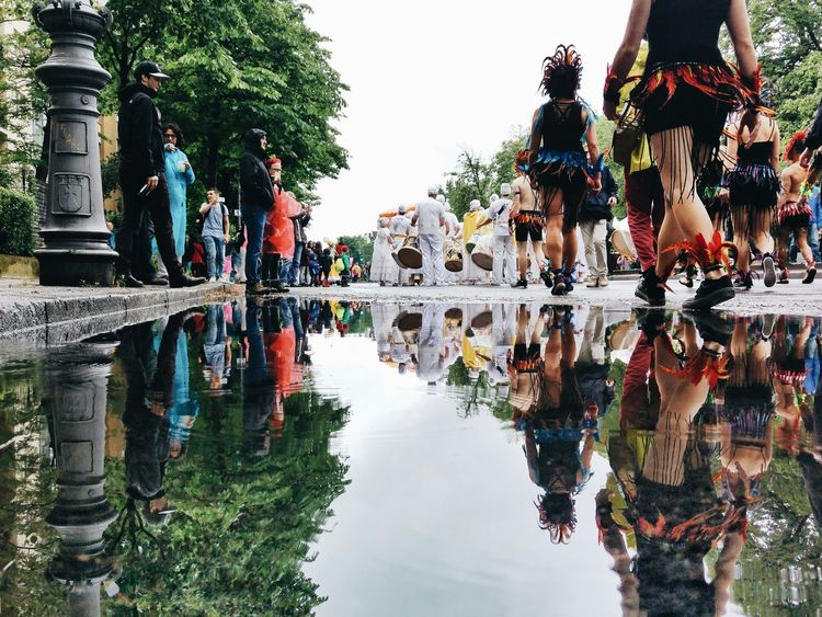 Water Reflection Outdoors Day Vacations People Large Group Of People Tree Adult Sky City Carnival Carnival Crowds And Details Karneval Der Kulturen Karneval Berlin Berliner Ansichten Kreuzberg Puddle Puddleography Puddlereflection Discover Berlin