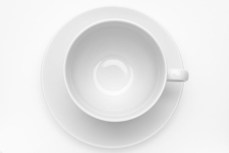 Empty white cup with saucer on white background Breakfast Coffee Dishware Espresso Hot Liquid Morning Porcelain  Tableware Backgrounds Blank Break Cafe Close-up Cup Cut Out Directly Above Empty Mug Object Plate Saucer Simple Tea Cup White