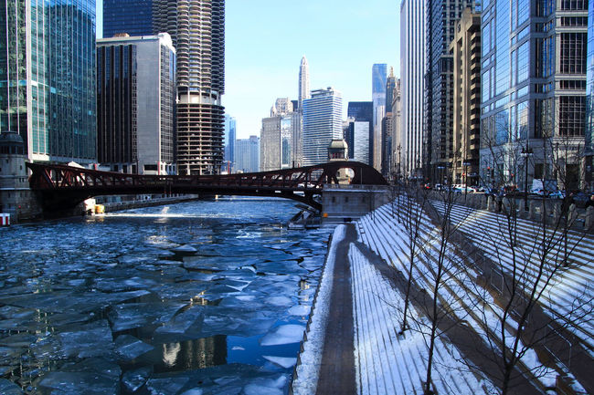 Snow covered riverwalk along a frozen Chicago winter during January. Chicago River Chicago Riverwalk Ice Winter Architecture Bridge - Man Made Structure Building Exterior Built Structure City Cityscape Connection Day Downtown District Modern Nature No People Outdoors River Skyscraper Snow Tower Travel Destinations Urban Skyline Water Waterfront