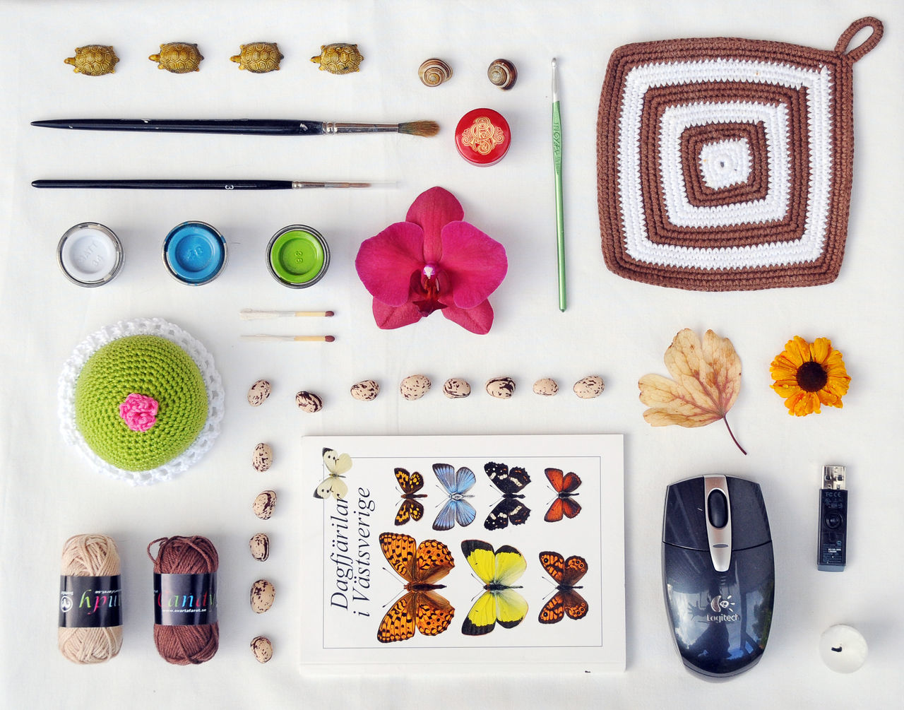 large group of objects, still life, variation, arrangement, button, no people, multi colored, indoors, group of objects, neat, day