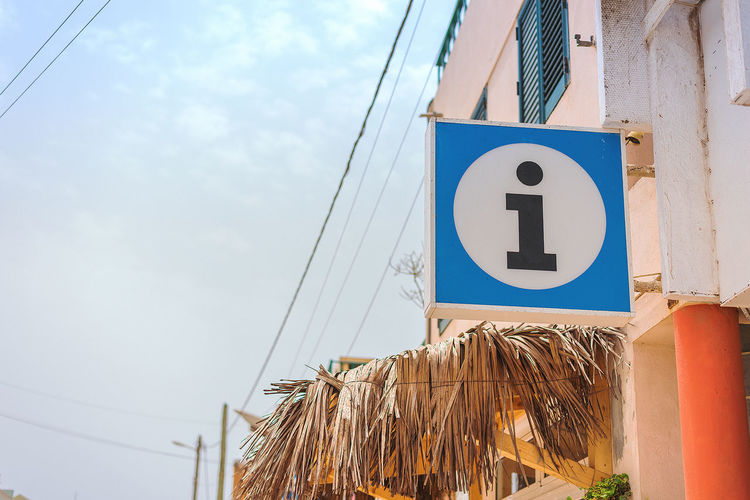 Tourist information sign in Cape Verde. Cape Verde Orange Tourist Information Sign Africa Blue Close-up Communication Day Low Angle View No People Number Outdoors Sky