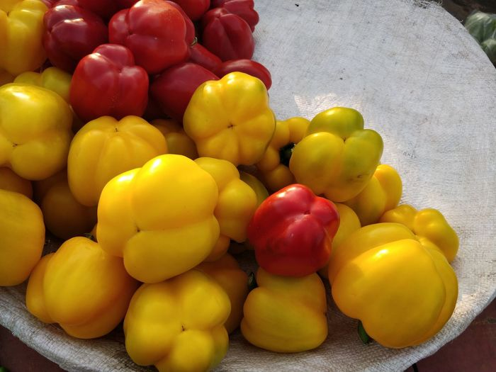 Food Food And Drink Healthy Eating Freshness Bell Pepper Pepper Large Group Of Objects Yellow Vegetable Wellbeing Close-up Retail  Red No People Abundance High Angle View Raw Food Choice Market Yellow Bell Pepper Street Market