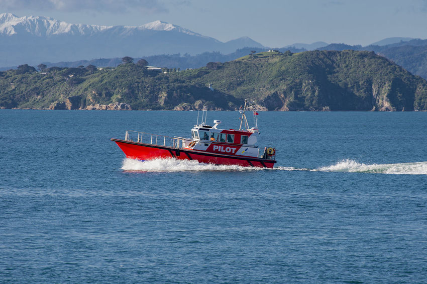 pilot vessel sailing to port with snowy peaks in the distance Mt Kaukau Silhouette Wellington  Backlit Boat Nautical Vessel Sea Vessel Water Wellington Pilot Boat