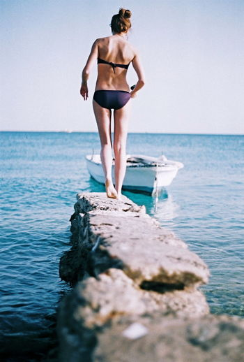 Beauty In Nature Bikini Boat Casual Clothing Day Full Length Girl Horizon Over Water Idyllic Jetty Leisure Activity Lifestyles Moored Nature Ocean Outdoors Scenics Sea Shore Sky Tranquil Scene Tranquility Vacations Water