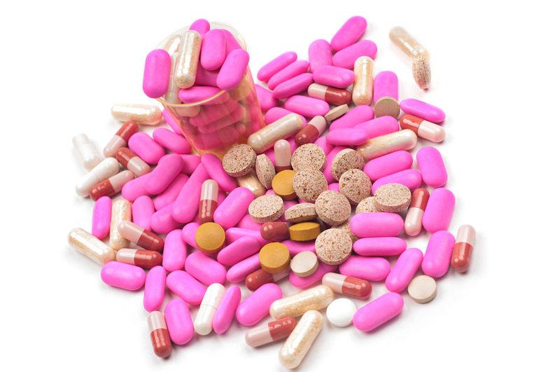 Multi colored pills over white background
