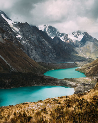 Huayhuash Trekking Cordillera Blanca Andes Reflection Blue Peru Mountain Water Beauty In Nature Scenics - Nature Sky Lake Tranquil Scene Tranquility Cloud - Sky Environment Nature Mountain Range Cold Temperature Landscape Non-urban Scene No People Idyllic Day Outdoors Turquoise Colored Snowcapped Mountain Mountain Peak