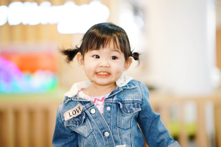 EyeEm Selects Childhood Portrait Looking At Camera Child One Person Casual Clothing Children Only Focus On Foreground Cute People Smiling Denim Jacket Headshot Day Happiness Human Body Part Cheerful Outdoors Close-up Adult