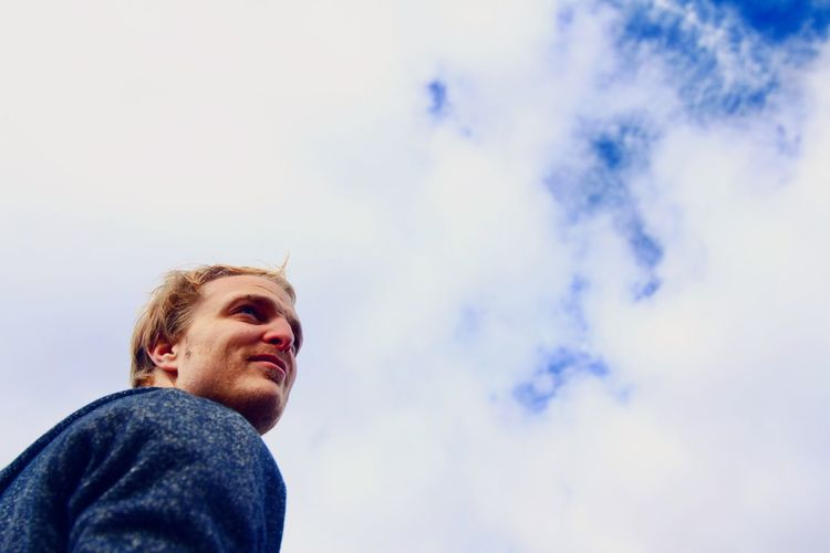 Dramatic Angles Low Angle View Young Men Young Adult Lifestyles Headshot Person Casual Clothing Men Cloud - Sky Sky Outdoors Handsome Cloudy Weekend Activities Front View Portrait Portraits Down Clouds And Sky Friends Flying Angles Focus On Foreground Leisure Activity